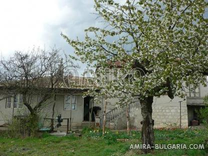 House in Bulgaria near a dam front 1
